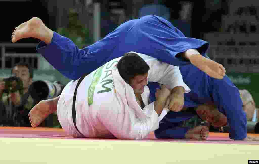 Derek Sua of Samoa and Abdullo Tangriev of Uzbekistan compete in the preliminary rounds of men's 100+ kilogram judo.