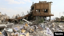 A building near Damascus lies in rubble after the attack.