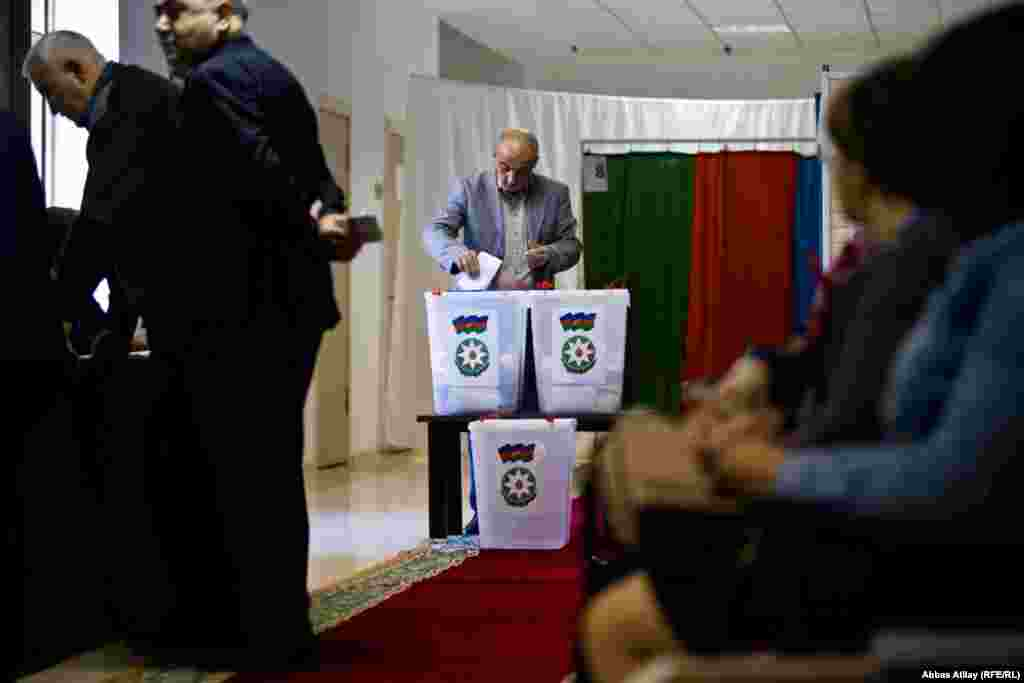 A man casts his ballot during the presidential election in Baku.