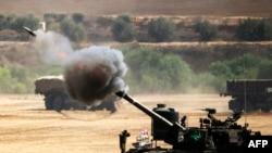 Израиль әскерилері Газа секторын атқылап жатыр. 30 шілде 2014 жыл.