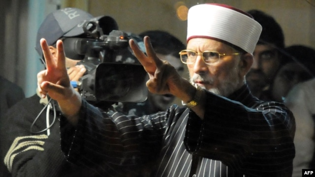 Tahir-ul Qadri flashes victory signs during a protest rally in Islamabad in January 2013.