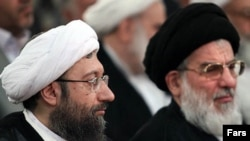 Ayatollah Sadeq Larijani (left) and outgoing judiciary chief Ayatollah Mahmud Hashemi-Shahrudi at Larijani's induction on August 17