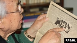 Zhumaghali Ismagulov, former director KazTAG, showing the reports that raised the Soviet ire, in a December 2009 photograph.