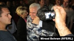 Zivko Budimir (facing camera, embracing a well-wisher after his release from prison in Mostar in May) and six other people are accused of arranging the pardons of 27 people without appropriate legal reasons to do so.
