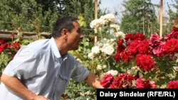 Azyn Yusupov, an ethnic Uzbek in the southern city of Osh, tends to his roses at his home in the city's Osh District, which was destroyed by fire during the June 2010 ethnic clashes.