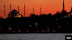 Turkey -- Hagia Sophia Museum (R) and Blue Mosque are seen during an Autumn sunset in Istanbul, 24Nov2008