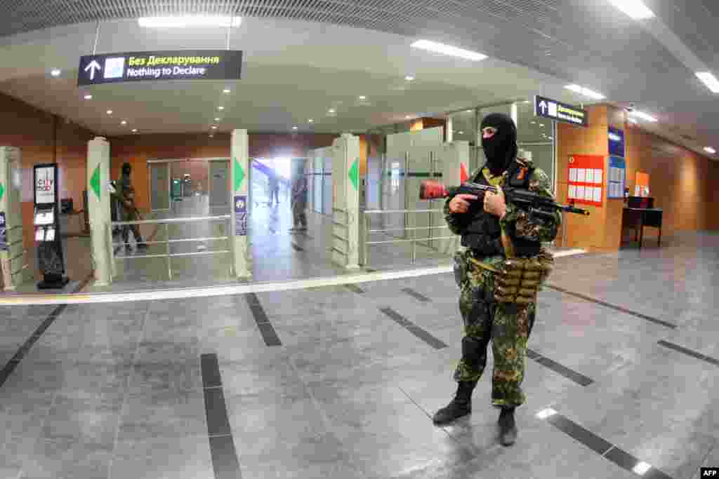 Pro-Russian militants patrolling Donetsk's international airport early on May 26, before the heavy fighting erupted.