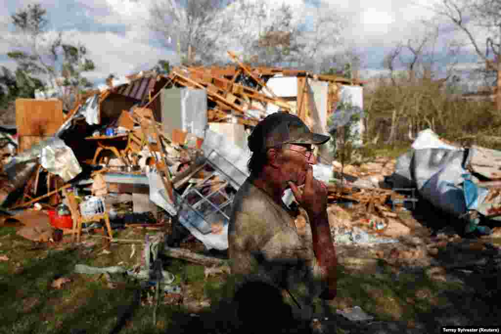 Bernard Sutton, 64, walks past the remains of his home, destroyed by Hurricane Michael in Fountain, Florida. (Reuters/Terray Sylvester)