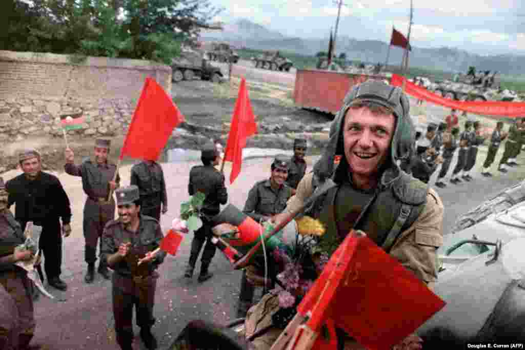 """February 1989: After nine years of fighting to prop up a communist government in Kabul, the Soviet Army pulls out of Afghanistan. Despite a carefully stage-managed withdrawal, the flowers and applause cannot conceal the shock of defeat for the """"invincible"""" Soviet Army. Around 15,000 Soviet troops had died in the conflict, along with more than 1 million Afghan civilians."""