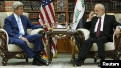 Iraqi Foreign Minister Ibrahim al-Jaafari (right) receives U.S. Secretary of State John Kerry in the library at the foreign minister's villa in Baghdad on April 8.