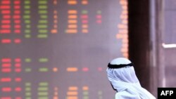 A Kuwaiti trader follows the market's movements.