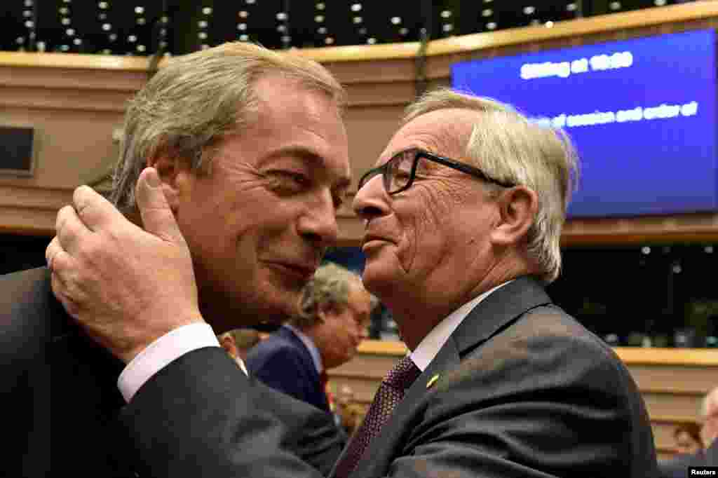 "European Commission President Jean-Claude Juncker playfully welcomes Nigel Farage, the leader of the U.K. Independence Party, prior to a plenary session at the European Parliament on the outcome of the ""Brexit"" vote, in Brussels. (Reuters/Eric Vidal)"