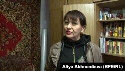Жительница дома в микрорайоне 9-я Площадка Маргарита Кутейникова. Талдыкорган, ноябрь 2015 года.