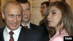 Then-Russian President Vladimir Putin (left) and rhythmic gymnastics champion Alina Kabayeva denied media speculation in 2008 that they were engaged.