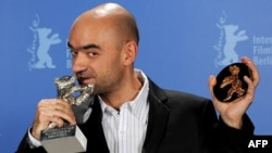 "Director Florin Serban poses with the ""Silver Bear"" in Berlin."