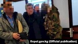 Adamkul Junusov (center) was extradited from Azerbaijan on December 28.
