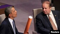 U.S. President Barack Obama and Pakistani Prime Minister Nawaz Sharif attend the opening session of the Nuclear Security summit at The Hague, March 24.