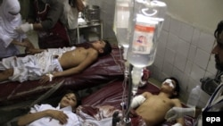 Students injured in the attack receive medical treatment at a local hospital in Peshawar.
