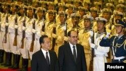المالكي أثناء زيارته الرسمية إلى الصين في 18 تموز 2011