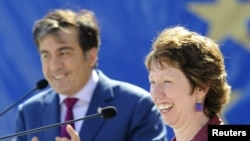 Georgian President Mikheil Saakashvili (left) and European Union High Representative Catherine Ashton in the Black Sea city of Batumi on July 15