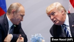 U.S. President Donald Trump (right) and Russian President Vladimir Putin speak at the G20 summit in Hamburg in July 2017.