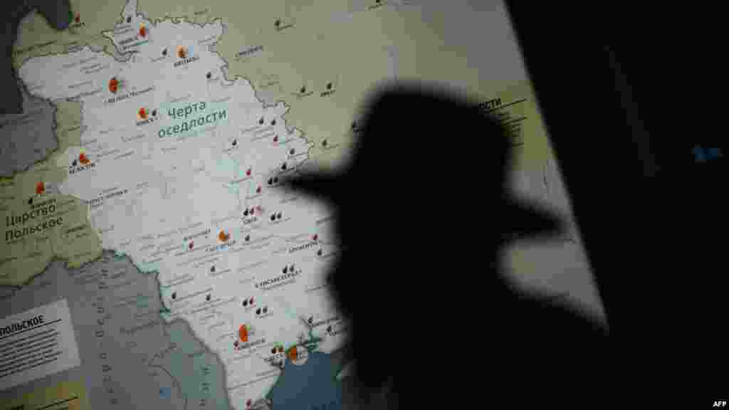 A visitor is silhouetted against a map in the Jewish Museum in Moscow, which opened on November 8.