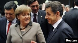 German Chancellor Angela Merkel (left) and French President Nicolas Sarkozy were both punished at the polls.