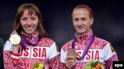 Yekaterina Poistogova (right) with Mariya Savinova of Russia at the London 2012 Olympics