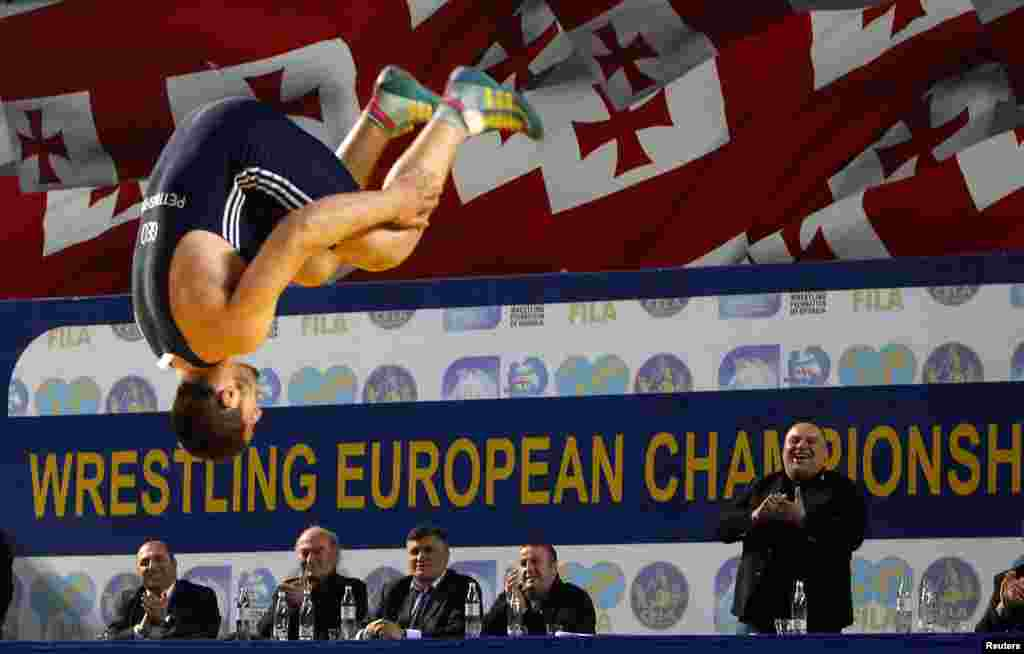 Georgia's Geno Petriashvili celebrates after winning a bronze medal during the Free Style Wrestling 120kg bronze-medal match against Germany's Nick Matuhin at the Senior Wrestling European Championship in Tbilisi. (Reuters/David Mdzinarishvili)