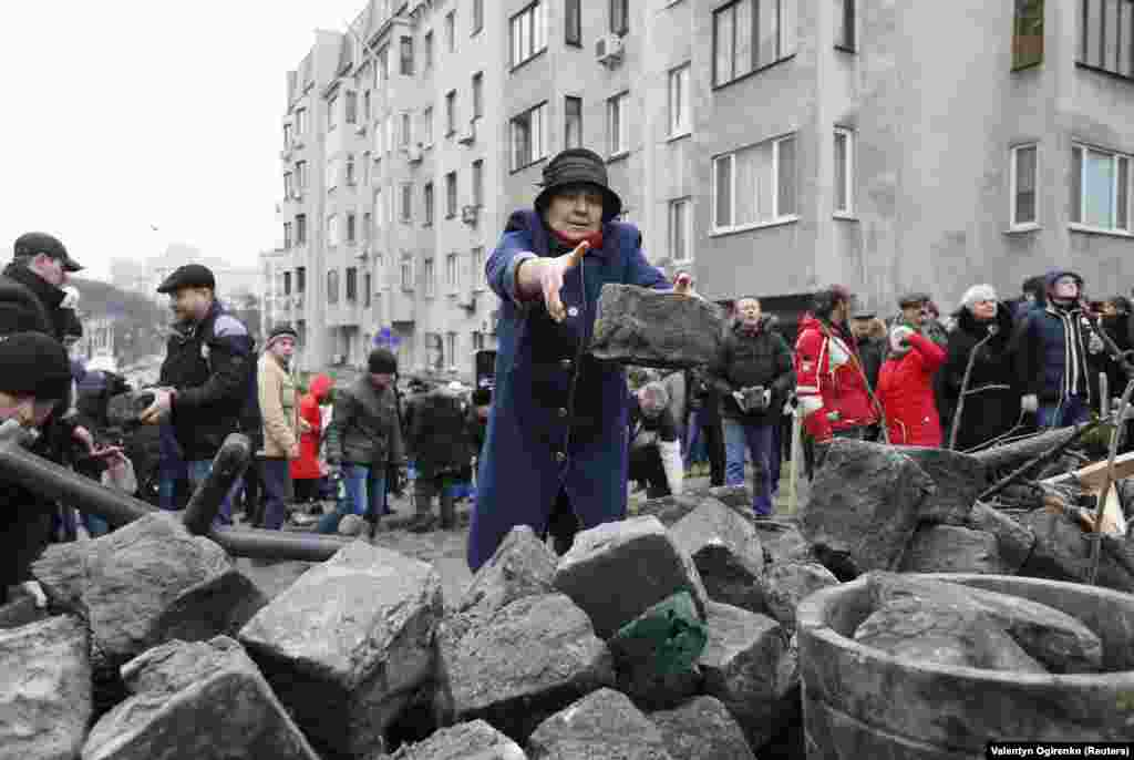 Saakashvili's supporters move paving stones during a standoff with police in Kyiv on December 5.