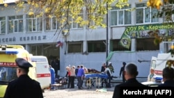 UKRAINE -- Rescuers carry an injured victim of a blast at at a college in the city of Kerch, Crimea, October 17, 2018