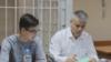 Владимир Жоглик и его адвокат на заседании суда