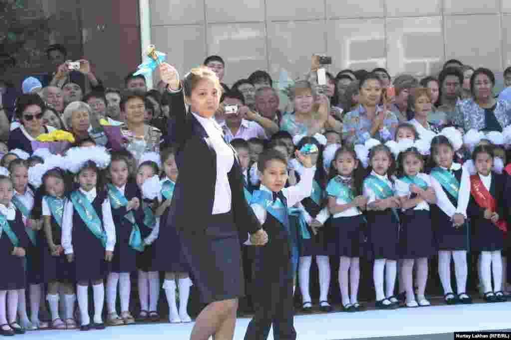 Children wear sashes in Almaty, Kazakhstan.