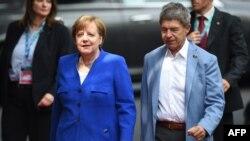 Федеральный канцлер ФРГ Ангела Меркель и ее супруг Иоахим Зауэр