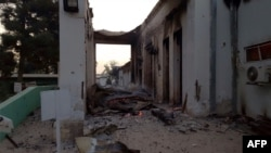 File photo of fires burning in parts of the MSF hospital in Kunduz after it was hit by an air strike in early October.