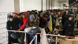 Migrants line up outside the Berlin Office of Health and Social Affairs to register on December 9, 2015.