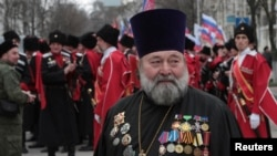 A Russian Orthodox priest attends a rally marking the second anniversary of Russia's annexation of Ukraine's Crimea region in the Black Sea port of Sevastopol on March 18.