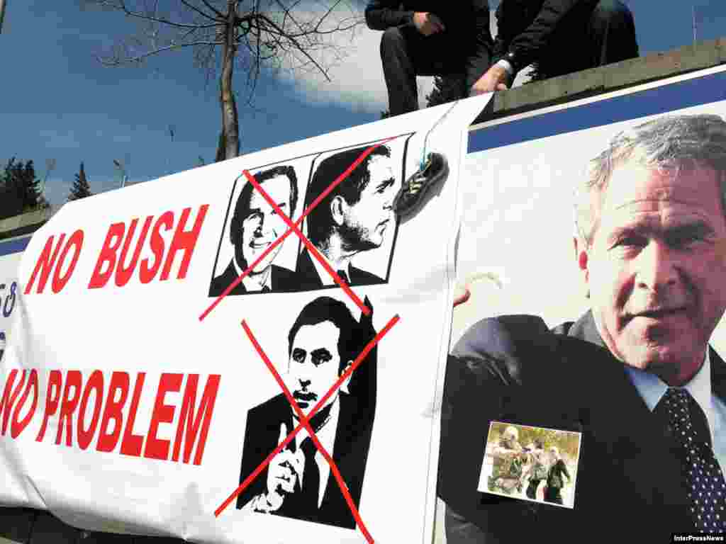 Protesters gather on March 25 near a banner hanging over a sign marking George W. Bush Street in Tbilisi. - Many are unhappy that a street in the Georgian capital has been renamed in honor of the former U.S. president. Photo by Inter Press News