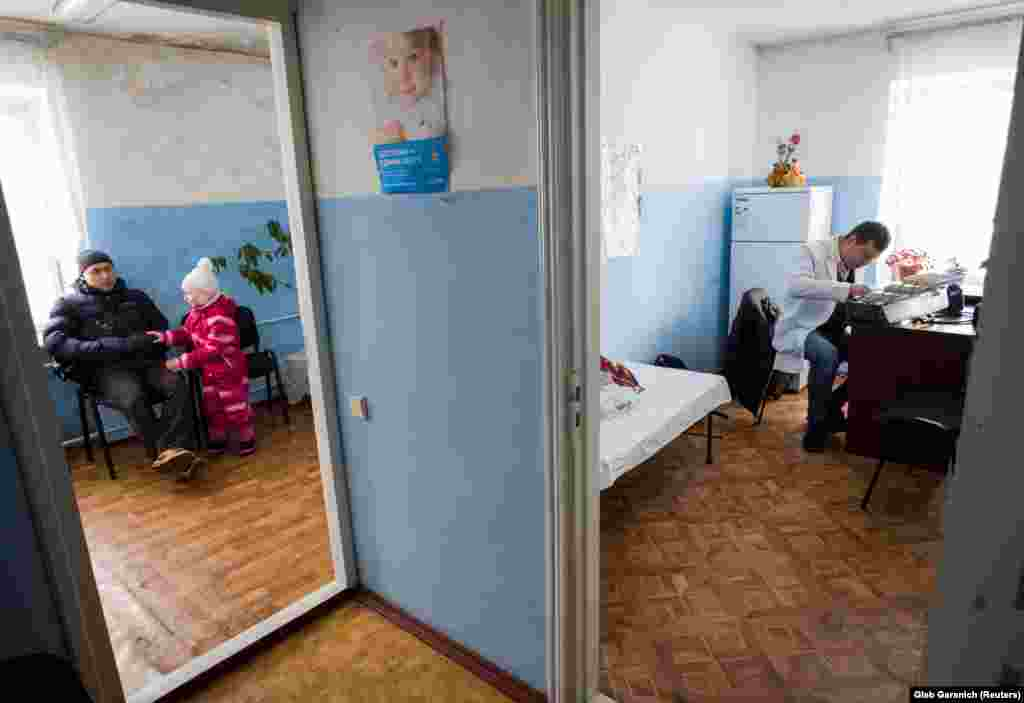 Rozumiy (right) in a small clinic in the village of Zeleniy Bir. In October 2017, Ukraine's parliament approved a long-delayed overhaul of the health system.
