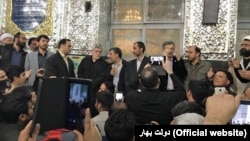 Former Iranian president Mahmoud Ahmadinejad (C) alongside his aides speaking at a gathering in a shrine near Tehran on Saturday November 18, 2017.