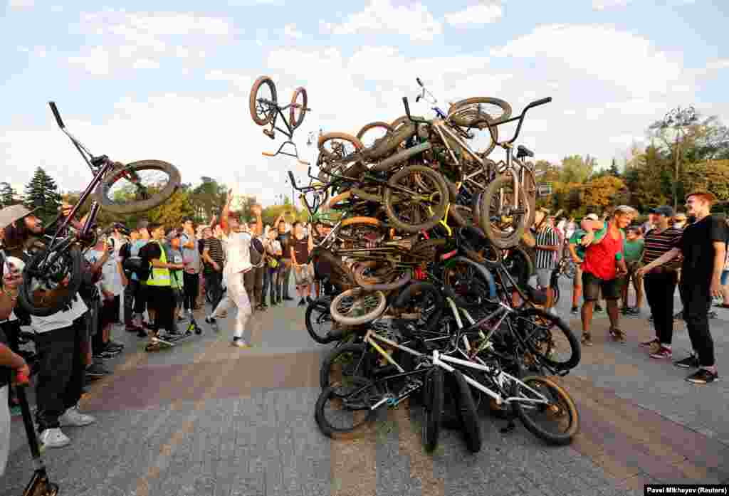 Riders throw their bikes in a heap after a mass ride in Almaty, Kazakhstan. (Reuters/Pavel Mikheyev)