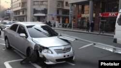 Armenia - A car damaged in an accident in downtown Yerevan.