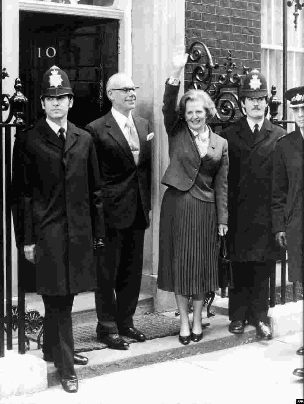 British Prime Minister Margaret Thatcher waves as she arrives at 10 Downing Street to take office on May 4, 1979.