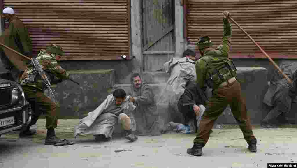 Indian police beat Kashmiri demonstrators in 2008. Indian authorities have been accused of unlawful killings, torture, and sexual violence against civilians in the ongoing conflict.