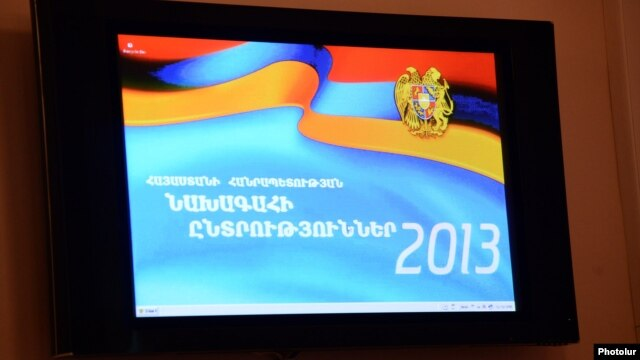 Armenia -- The official banner of the February 2013 presidential elecition projected from a monitor at the Central Election Commission, Yerevan, 14Jan2013.