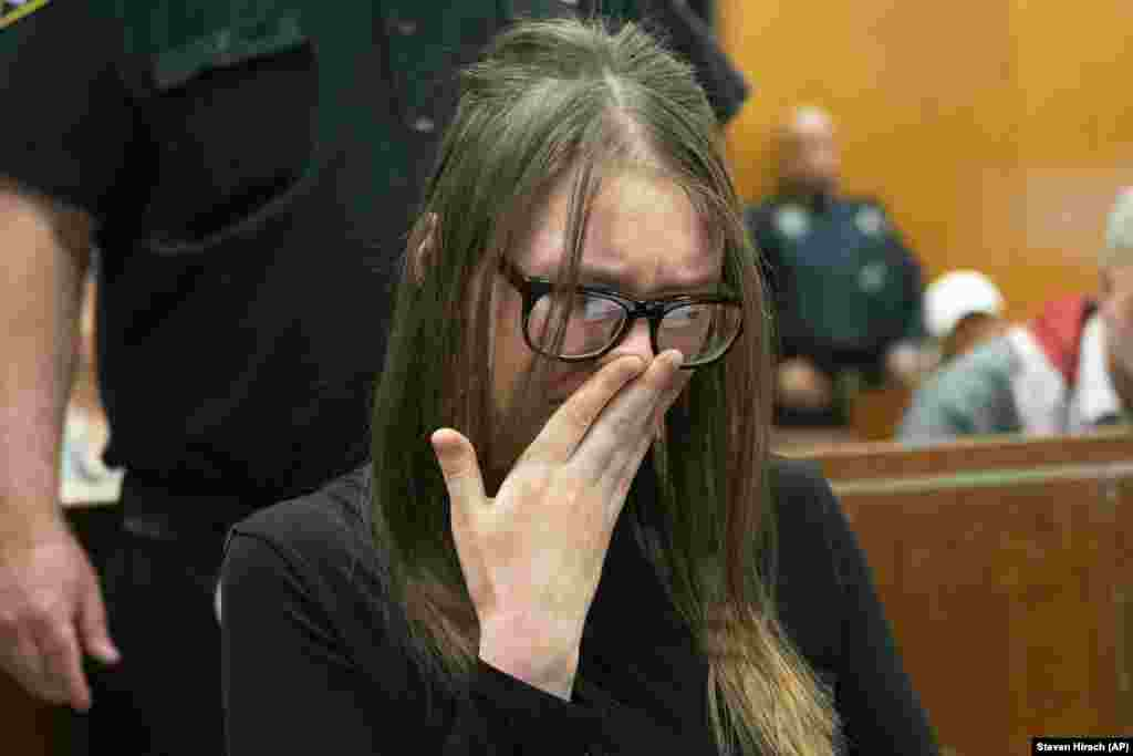 Anna Sorokin cries during her sentencing at the New York State Supreme Court in New York on May 9. Sorokin, the Russian-born con artist who passed herself off as a wealthy heiress to swindle banks, hotels, and even close friends, was sentenced to four to 12 years behind bars. (AP/Steven Hirsch/New York Post)