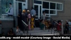 Uzbekistan - people are waiting to take money from People's bank of Uzbekistan in Ferghana region, 12 July 2014.