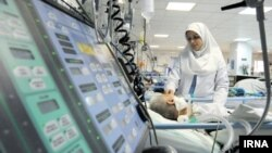 A nurse attending a patient in an Iranian hospital. File photo