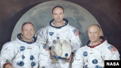 "Neil Armstrong (left) with his fellow crew members from the Apollo 11 mission, Michael Collins (center) and Edwin ""Buzz"" Aldrin."