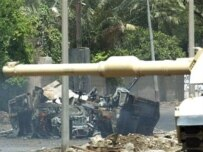 A U.S. military vehicle destroyed in one of Baghdad's latest roadside bomb attacks, July 11 (AFP)